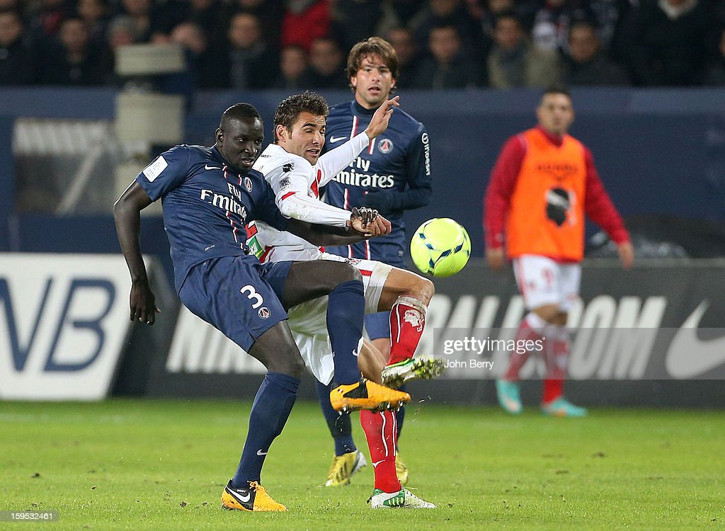 Mamadou Sakho (L) of PSG fights for the ball with Adrian Mutu of AC Ajaccio while Maxwell of PSG looks on during the French Ligue 1 match between Paris Saint Germain FC and AC Ajaccio at the Parc des Princes stadium on January 11, 2013 in Paris, France.