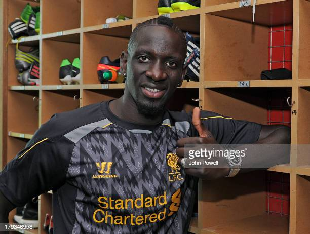 Mamadou Sakho poses for a photo after signing a contract for Liverpool Football Club at Melwood Training Ground on August 31 2013 in Liverpool United...