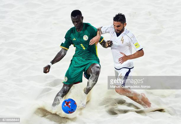 Mamadou Sylla of Senegal competes for the ball with Michele Di Palma of Italy during the FIFA Beach Soccer World Cup Bahamas 2017 quarter final match...