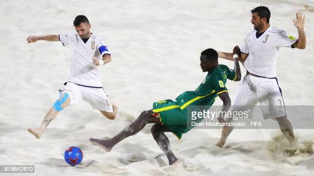 Mamadou Sylla of Senegal Francesco Corosiniti and Matteo Marrucci of Italy during the FIFA Beach Soccer World Cup Bahamas 2017 quarter final match...