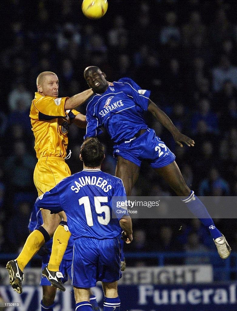 Mamady Sidibe jumps for the ball during the Nationwide League Division One match between Gillingham and Leicester City at The Priestfield Stadium in Gillingham on January 18, 2003 in Gillingham, England.
