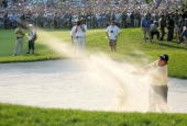 Phil Mickelson of the US hits out of the sand on the 18th hole during the final round of the 2006 US Open Championships 18 June 2006 at Winged Foot...