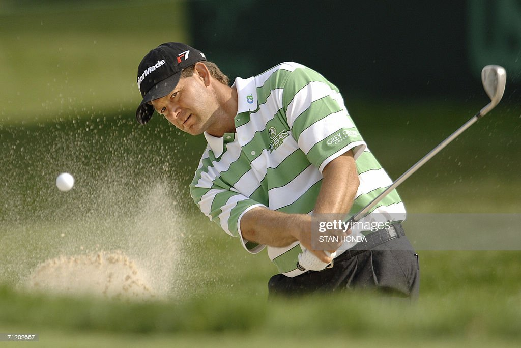 Retief Goosen of South Africa hits out of a sand trap on the 5th green during a practice round for the US Open Championship 14 June 2006 at Winged...