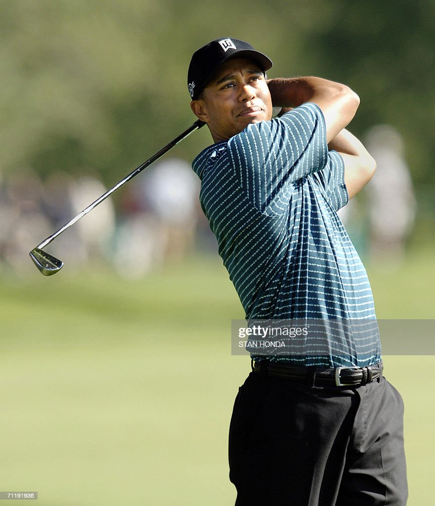 Tiger Woods hits from the 9th fairway during a practice round for the US Open Championships 13 June 2006 at Winged Foot Golf Club in Mamaroneck NY...