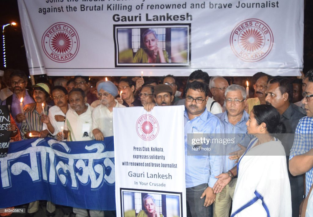 Mamata Banerjee (R) Chief Minister of West Bengal takes part in the Candle Light rally along Kolkata Press Club organized a mass silent protest of Indian journalist Gauri Lankesh at a protest demonstration against her killing in Kolkata, India on 6 September 2017.