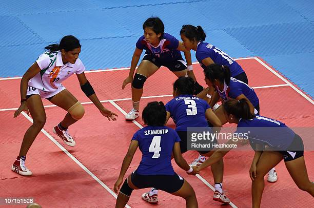 Mamatha of India sucessfully scores a point as she raids the Thailand defence in the Women's Kabaddi final at Nansha Gymnasium during day fourteen of...