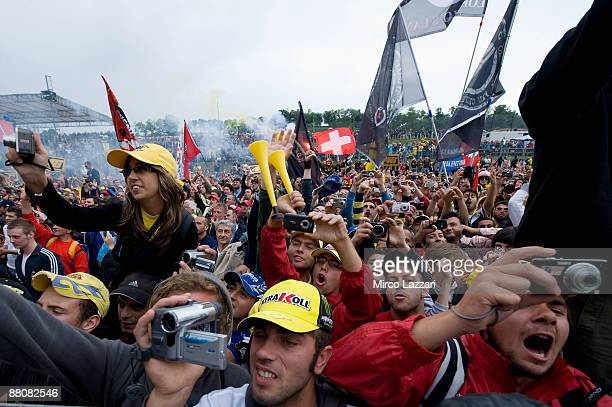 Mambers of the public throng the track following the MotoGp race at the Mugello circuit on May 31 2009 in Florence Italy