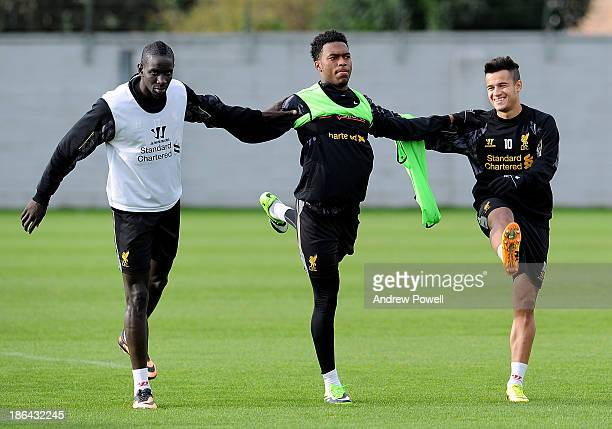 Mamdou Sakho Daniel Sturridge and Philippe Coutinho of Liverpool in action during a training session at Melwood Training Ground on October 31 2013 in...