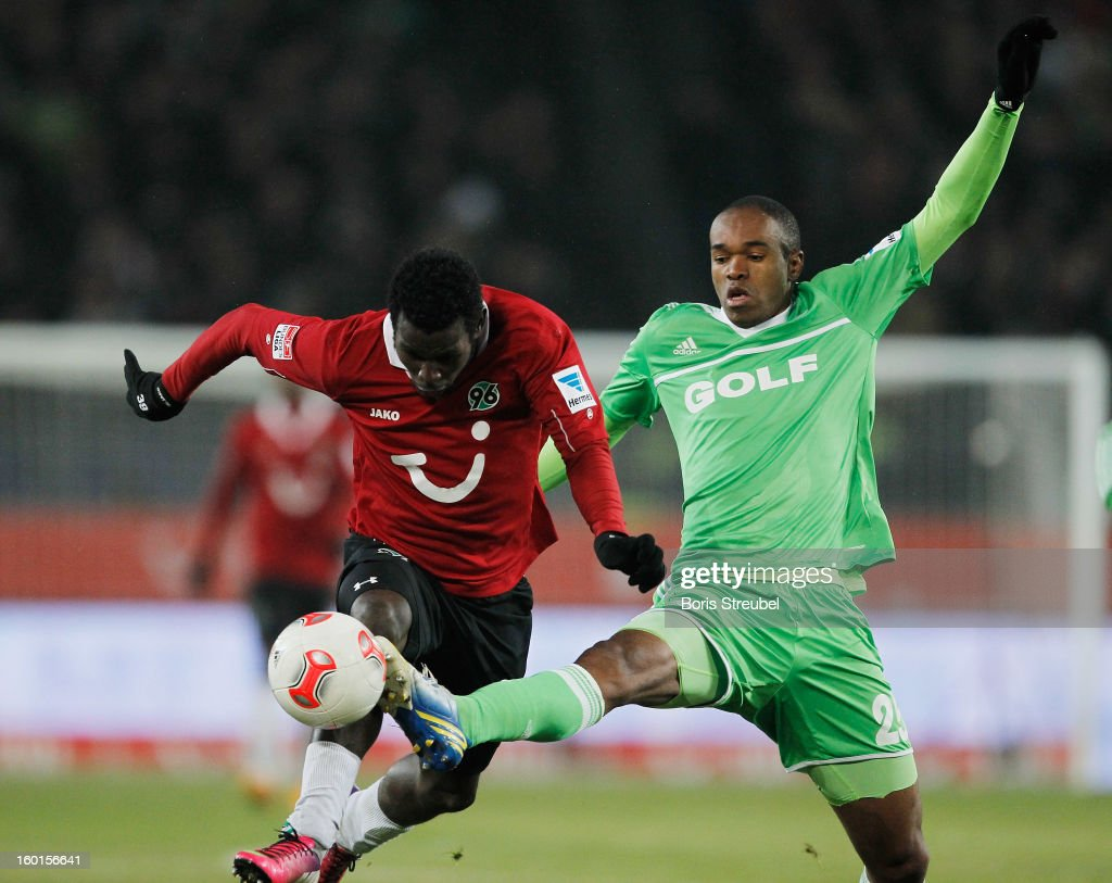 Mame Biram Diouf (L) of Hannover and Naldo (L) of Wolfsburg battle for the ball during the Bundesliga match between Hannover 96 and VfL Wolfsburg at AWD Arena on January 26, 2013 in Hannover, Germany.
