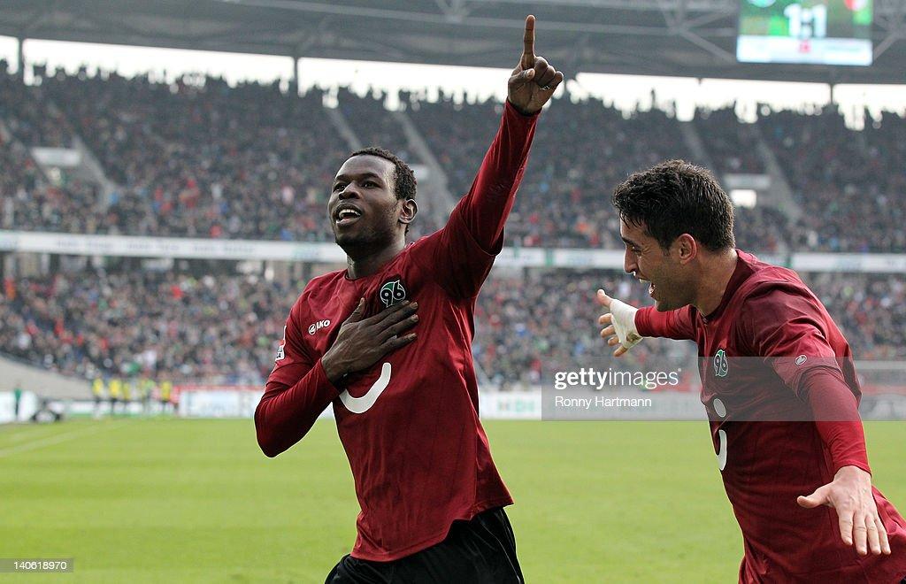 Mame Biram Diouf of Hannover celebrates his teams second goal with Karim Haggui during the Bundesliga match between Hannover 96 and FC Augsburg at...