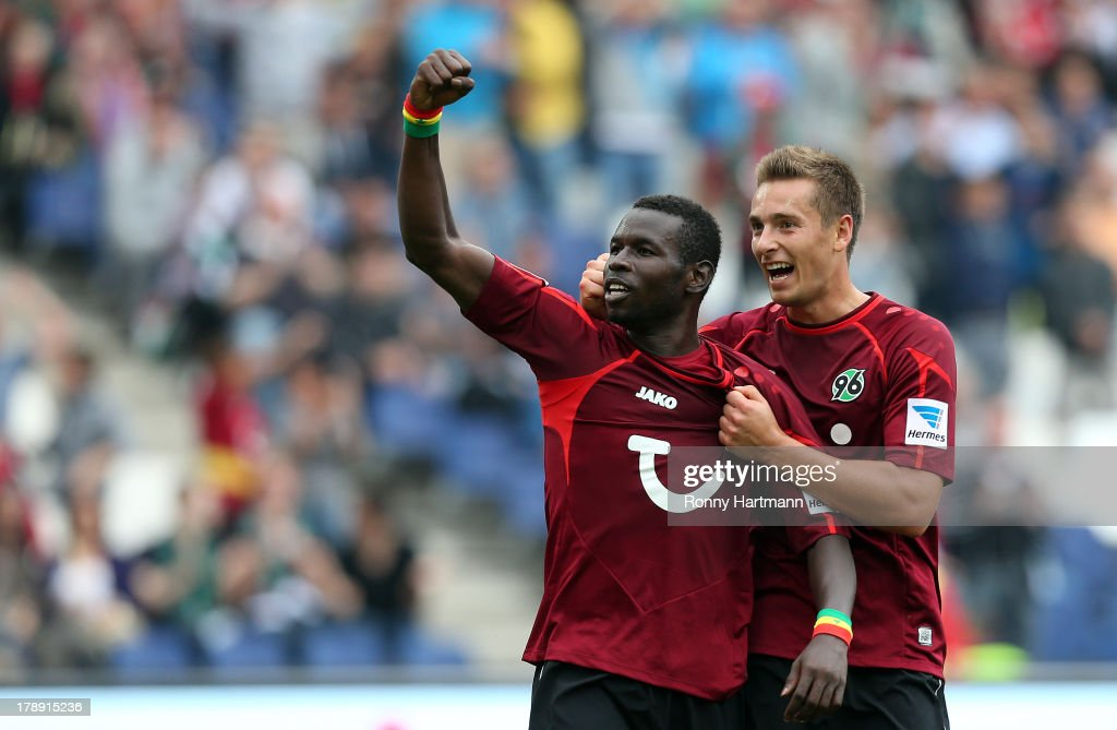 <a gi-track='captionPersonalityLinkClicked' href=/galleries/search?phrase=Mame+Biram+Diouf&family=editorial&specificpeople=8255767 ng-click='$event.stopPropagation()'>Mame Biram Diouf</a> (L) of Hannover celebrates scoring his team's first goal with Artur Sobiech of Hannover the Bundesliga match between Hannover 96 and 1. FSV Mainz 05 at HDI Arena on August 31, 2013 in Hannover, Germany.