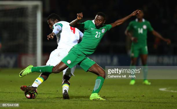 Mame Biram Diouf of Senegal and Wilfred Ndidi of Nigeria during the International Friendly match between Nigeria and Senegal at The Hive on March 23...