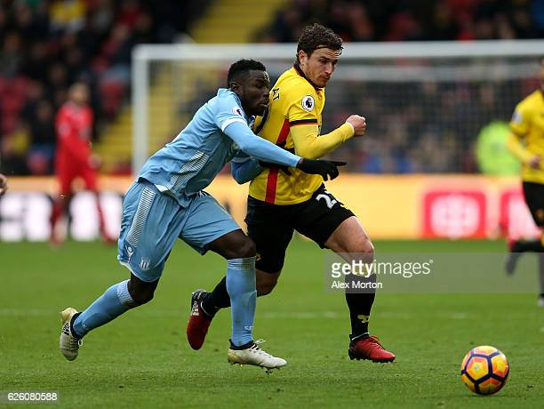 Mame Biram Diouf of Stoke City and Daryl Janmaat of Watford battle for possession during the Premier League match between Watford and Stoke City at...