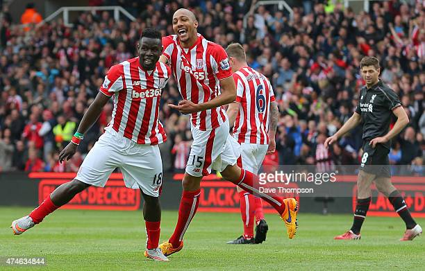 Mame Biram Diouf of Stoke City celebrates a goal with his team mates during the Barclays Premier League match between Stoke City and Liverpool at...