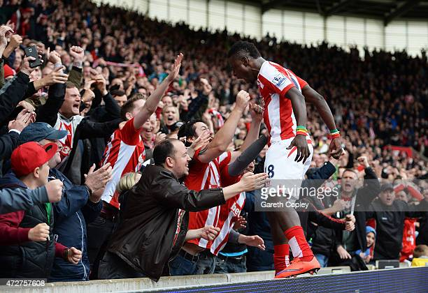 Mame Biram Diouf of Stoke City celebrates his team's third goal with fans during the Barclays Premier League match between Stoke City and Tottenham...