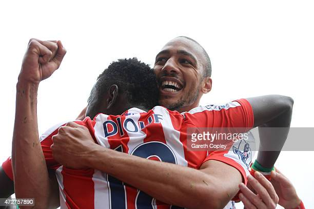 Mame Biram Diouf of Stoke City celebrates his team's third goal with Steven N'Zonzi of Stoke City during the Barclays Premier League match between...