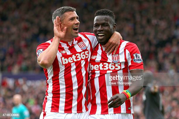 Mame Biram Diouf of Stoke City celebrates scoring a goal with his team mate Jonathan Walters during the Barclays Premier League match between Stoke...