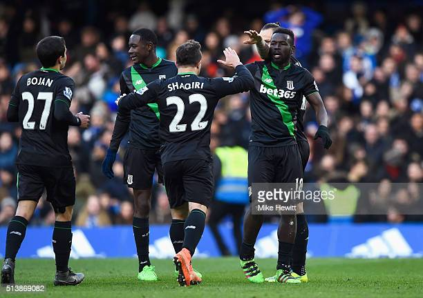 Mame Biram Diouf of Stoke City celebrates scoring his team's first goal with his team mates during the Barclays Premier League match between Chelsea...