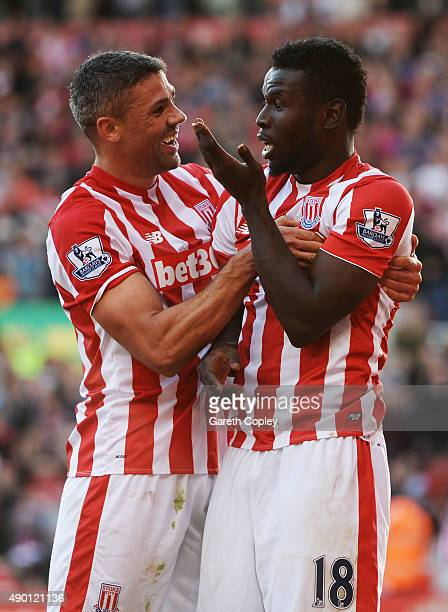 Mame Biram Diouf of Stoke City celebrates scoring his team's second goal with his team mate Jonathan Walters during the Barclays Premier League match...