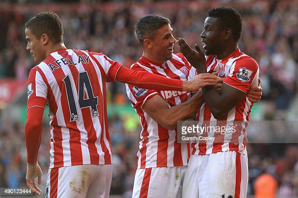 Mame Biram Diouf of Stoke City celebrates scoring his team's second goal with his team mates Jonathan Walters and Ibrahim Afellay during the Barclays...