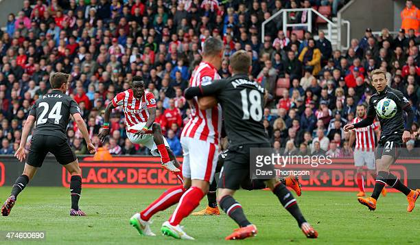 Mame Biram Diouf of Stoke City scores a goal during the Barclays Premier League match between Stoke City and Liverpool at Britannia Stadium on May 24...