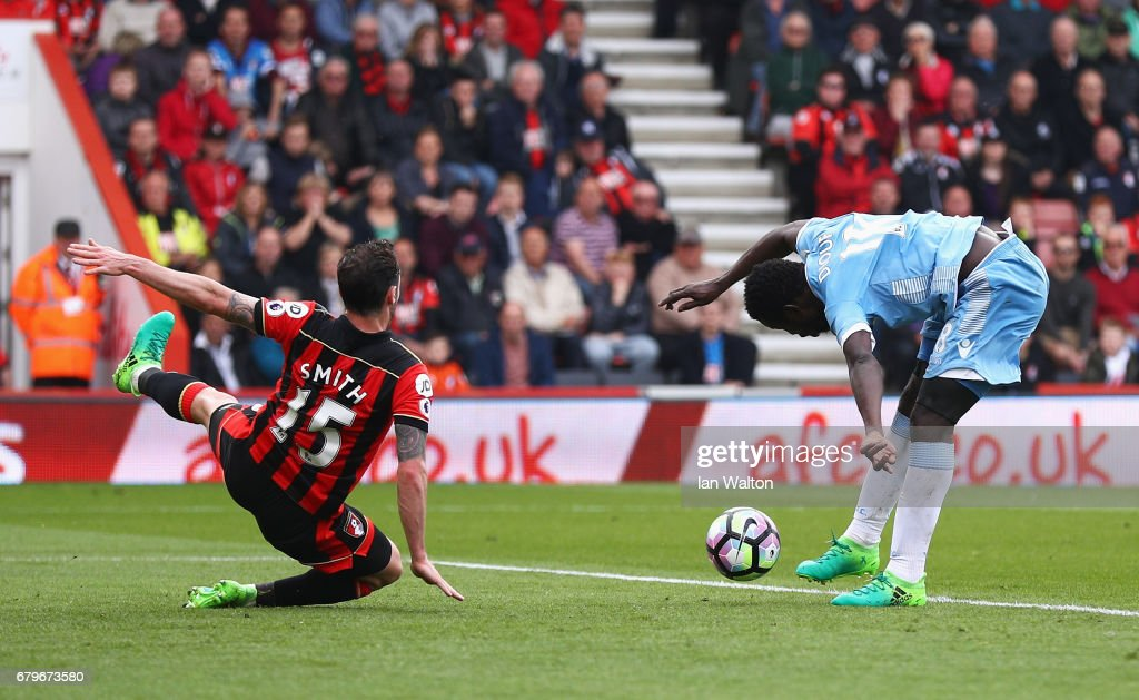 Mame Biram Diouf of Stoke City scores his sides second goal as Adam Smith of AFC Bournemouth attempts to block during the Premier League match between AFC Bournemouth and Stoke City at the Vitality Stadium on May 6, 2017 in Bournemouth, England.