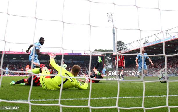 Mame Biram Diouf of Stoke City scores his sides second goal past Artur Boruc of AFC Bournemouth during the Premier League match between AFC...