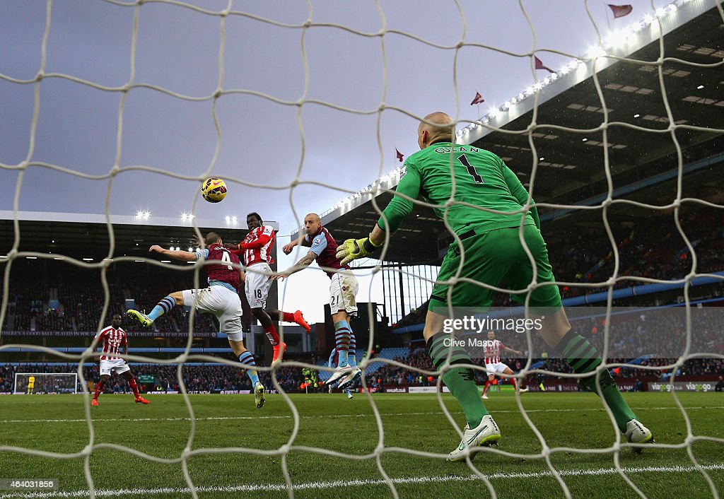Mame Biram Diouf of Stoke City scores their first goal past Brad Guzan of Aston Villa during the Barclays Premier League match between Aston Villa and Stoke City at Villa Park on February 21, 2015 in Birmingham, England.