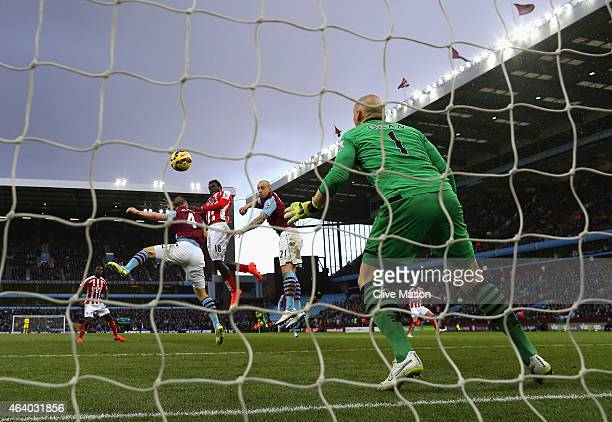 Mame Biram Diouf of Stoke City scores their first goal past Brad Guzan of Aston Villa during the Barclays Premier League match between Aston Villa...