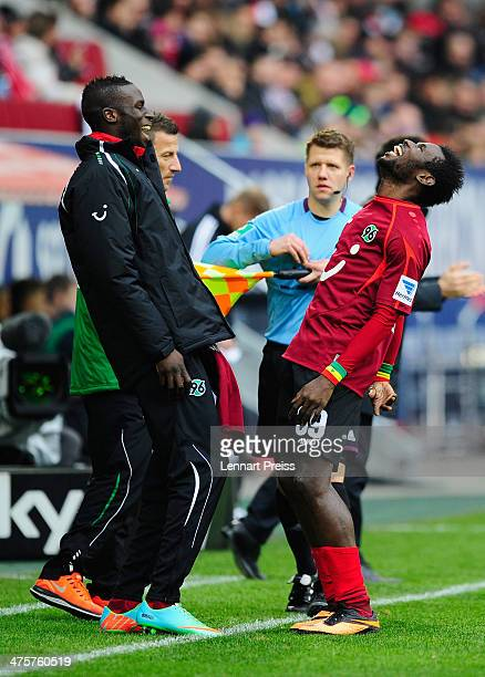 Mame Diouf and Salif Sane of Hannover celebrate the opening goal during the Bundesliga match between FC Augsburg and Hannover 96 at SGL Arena on...