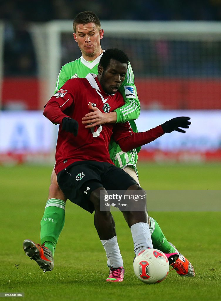 Mame Diouf (front) of Hannover and <a gi-track='captionPersonalityLinkClicked' href=/galleries/search?phrase=Alexander+Madlung&family=editorial&specificpeople=645968 ng-click='$event.stopPropagation()'>Alexander Madlung</a> (back) of Wolfsburg battle for the ball during the Bundesliga match between Hannover 96 and VfL Wolfsburg at AWD Arena on January 26, 2013 in Hannover, Germany.