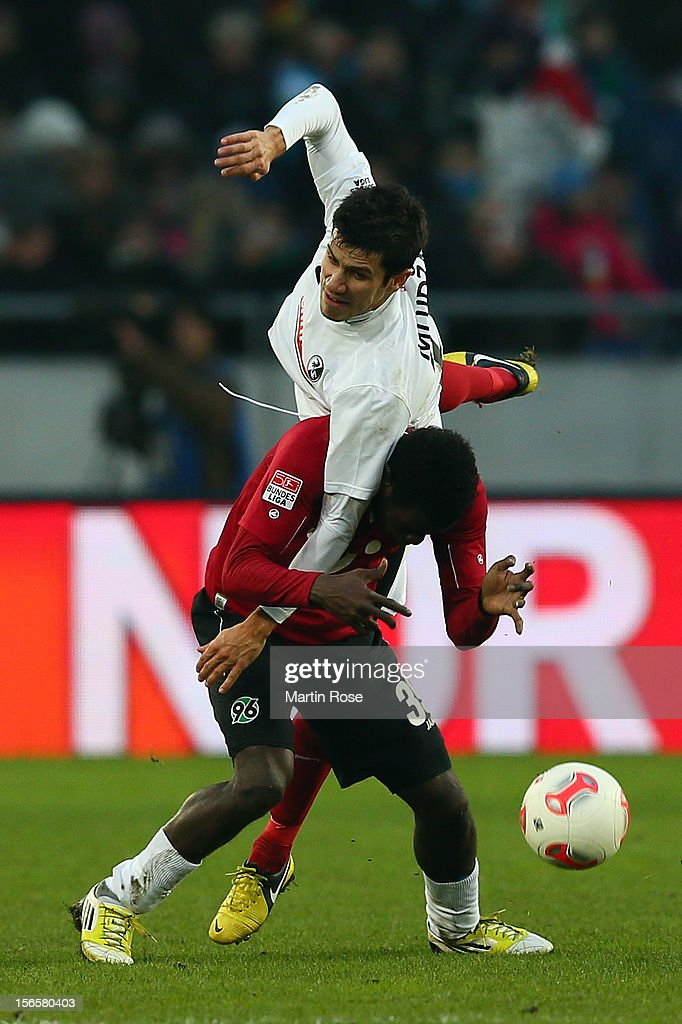 Mame Diouf (front) of Hannover and Mensur Mujdza (back) of Freiburg battle for the ball during the Bundesliga match between Hannover 96 and SC Freiburg at AWD Arena on November 17, 2012 in Hannover, Germany.