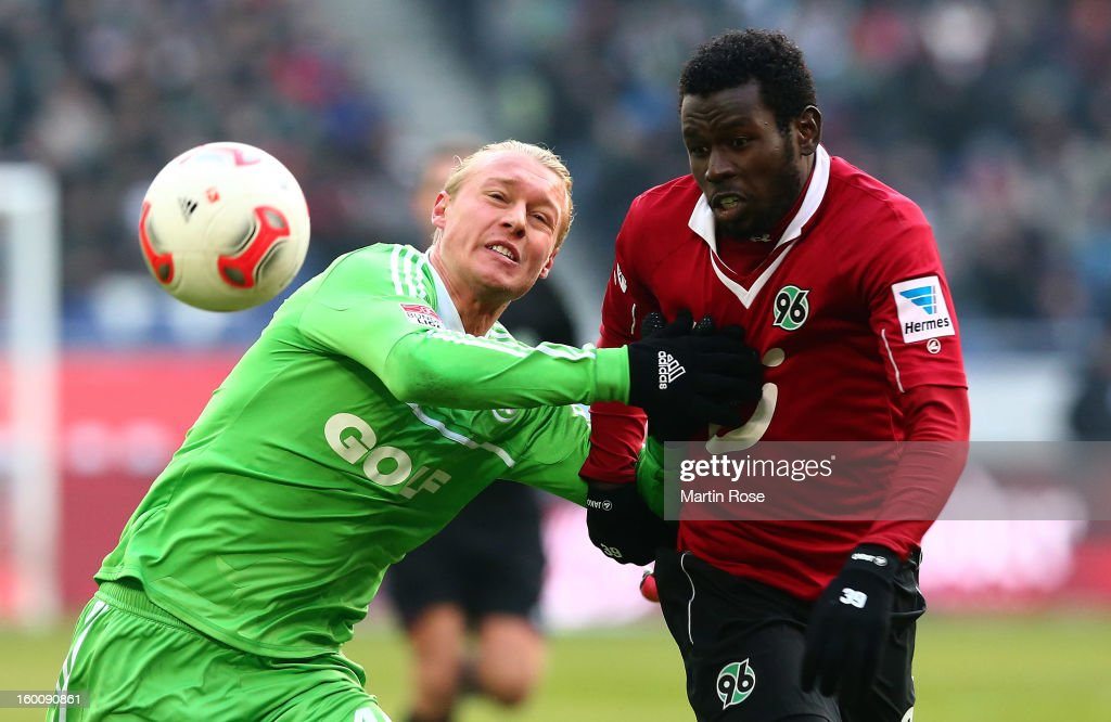 Mame Diouf (R) of Hannover and <a gi-track='captionPersonalityLinkClicked' href=/galleries/search?phrase=Simon+Kjaer&family=editorial&specificpeople=4895333 ng-click='$event.stopPropagation()'>Simon Kjaer</a> (L) of Wolfsburg battle for the ball during the Bundesliga match between Hannover 96 and VfL Wolfsburg at AWD Arena on January 26, 2013 in Hannover, Germany.
