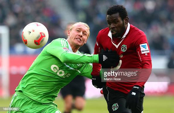 Mame Diouf of Hannover and Simon Kjaer of Wolfsburg battle for the ball during the Bundesliga match between Hannover 96 and VfL Wolfsburg at AWD...