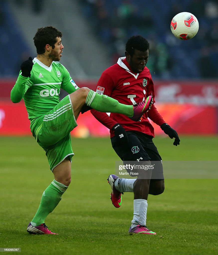 Mame Diouf (R) of Hannover and Vieirinha(L) of Wolfsburg battle for the ball during the Bundesliga match between Hannover 96 and VfL Wolfsburg at AWD Arena on January 26, 2013 in Hannover, Germany.