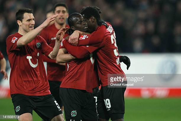 Mame Diouf of Hannover celebrates the third goal with Mario Eggimann and Didier Ya Konan during the Bundesliga match between Hanover 96 and 1 FC...
