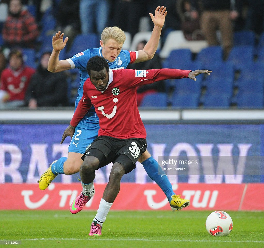 Mame Diouf of Hannover is challenged by Andreas Beck of Hoffenheim during the Bundesliga match between Hannover 96 and TSG 1899 Hoffenheim at AWD Arena on February 9, 2013 in Hannover, Germany.