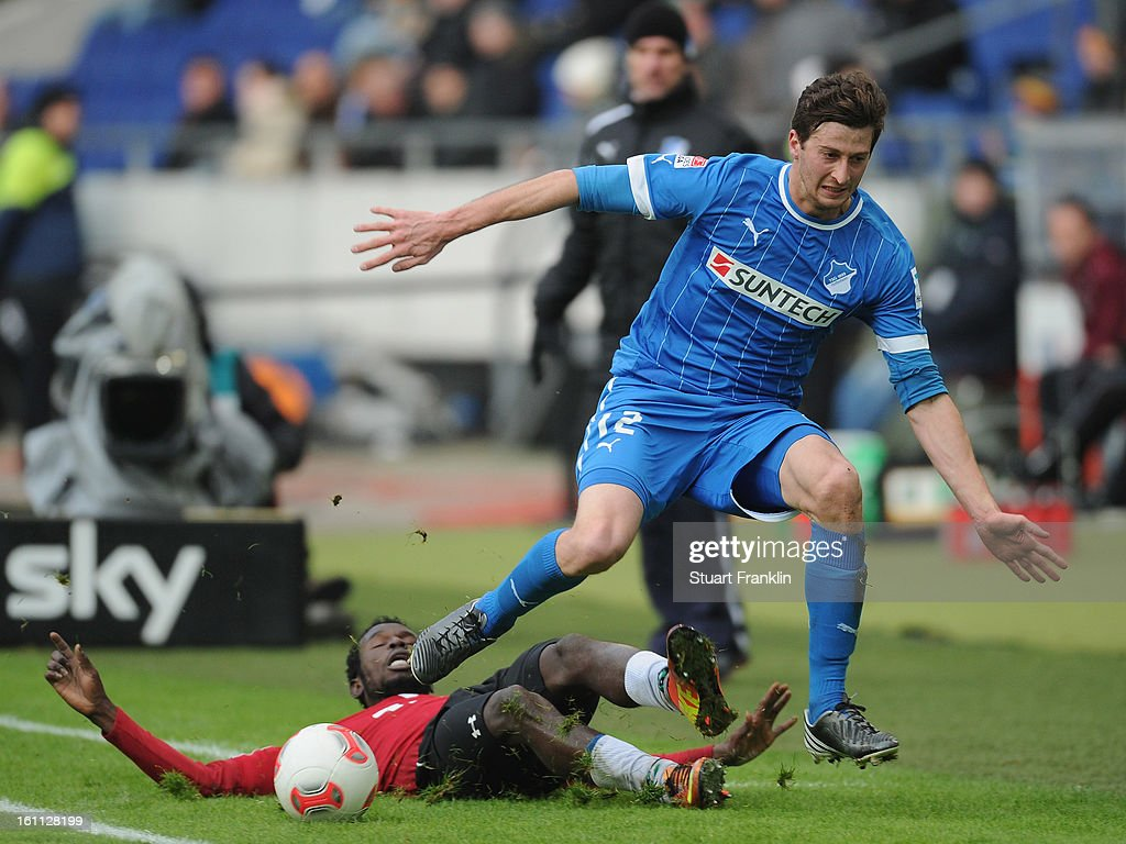 Mame Diouf of Hannover is challenged by David Angel Abraham of Hoffenheim during the Bundesliga match between Hannover 96 and TSG 1899 Hoffenheim at AWD Arena on February 9, 2013 in Hannover, Germany.