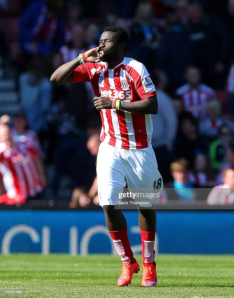 Mame Diouf of Stoke celebrates scoring his team's first goal during the Barclays Premier League match between Stoke City and Southampton at the Britannia Stadium on April 18, 2015 in Stoke on Trent, England.