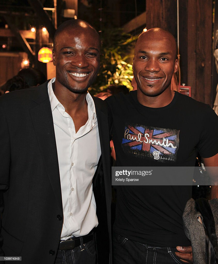 Mamedy Doucara and Ladji Doucoure attend the launch of Mamedy Doucara's Charity Exhibition at Le Comptoir General on September 9, 2010 in Paris, France.