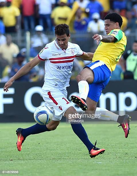 Mamelodi Sundowns' Keagan Dolly fights for the ball against Zamalek' Ahmed Hassan during the first length of the CAF Championship final on October 15...
