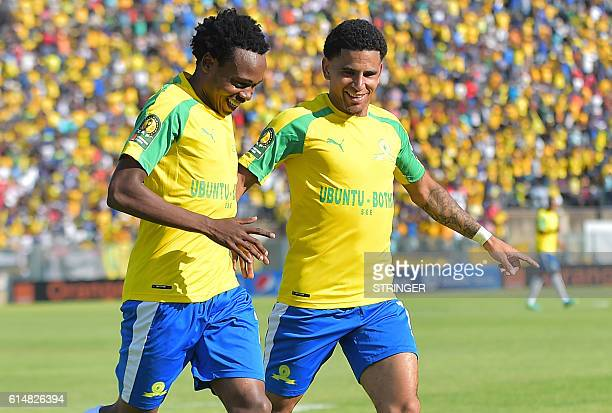 Mamelodi Sundowns' Percy Tau is congratulated by teammate Keagan Dolly after scoring a goal during the CAF Championship final football match Mamelodi...