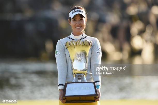 Mami Fukuda of Japan holds the trophy after winning the Itoen Ladies Golf Tournament 2017 at the Great Island Club on November 12 2017 in Chonan...