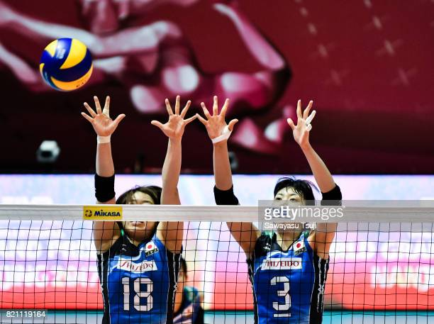 Mami Uchiseto and Nana Iwasaka of Japan block the ball during the FIVB Volleyball World Grand Prix match between Japan and Russia on July 23 2017 in...