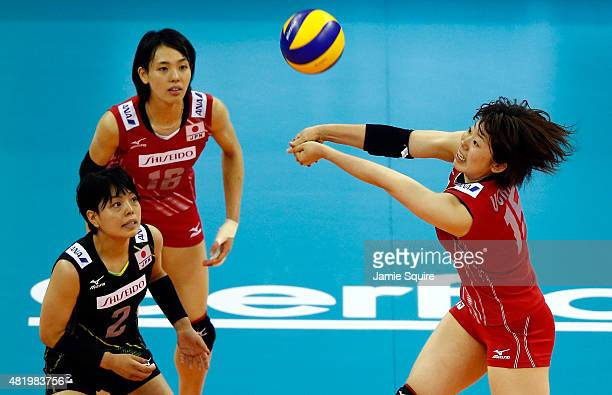 Mami Uchiseto of Japan returns a serve as Kotoki Zayasu and Saori Sakoda watch during the final round match against Italy on day 4 of the FIVB...
