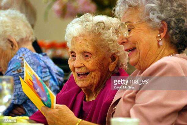 Mamie Underhill and her daughter Leita Chapman laugh while reading a birthday card for Mamie during a birthday celebration for five women residents...