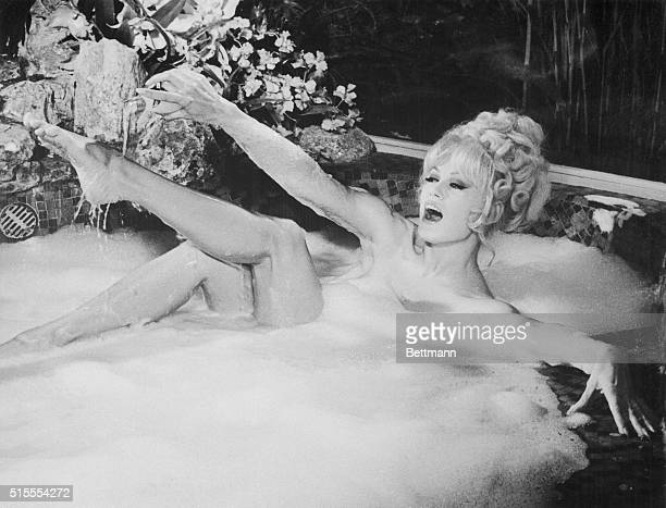 Mamie Van Doren has to take a beer bath in The three Nuts In Search Of A Bolt a NoonanMcGlashan production in which she stars opposite Tommy Noonan...