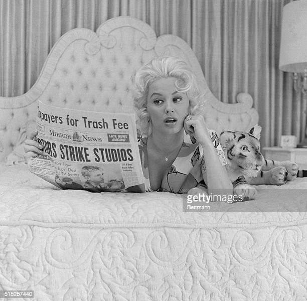 Mamie Van Doren Lying in Bed with Newspaper