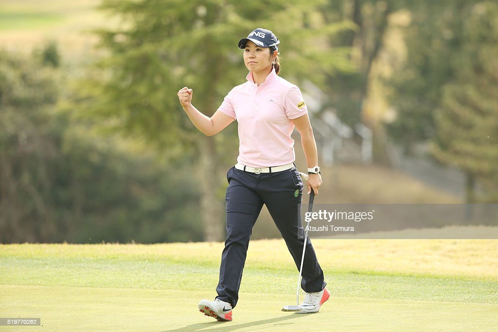 Mamiko Higa of Japan celebrates after making her birdie putt on the 18th hole during the first round of the Studio Alice Open at the Hanayashiki Golf...