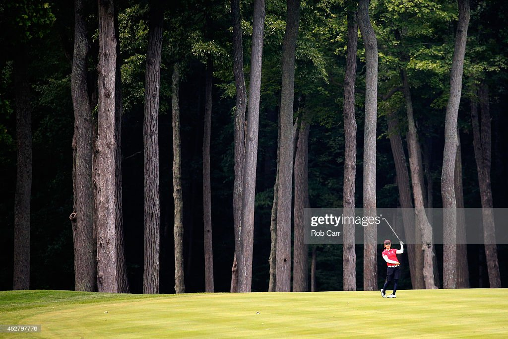 Mamiko Higa of Japan follows her second shot to the 4th green during the final round of the International Crown at Cave Valley Golf Club on July 27...